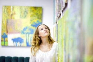 Woman-gazing-at-artwork-on-the-wall-cm